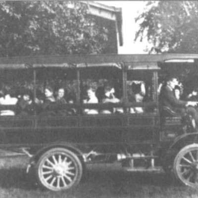 School bus for children going to the Grange when it was the public school.