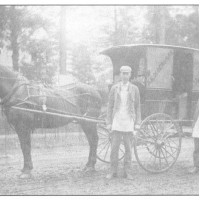 The horsedrawn wagon of Mr. Oldershaw was for delivering milk to village residents who would come out with jars to buy his milk. Mr. Oldershaw's son was a resident of the village for many years. He resided at 119 Main Street. Mr Oldershaw is standing to the rear of the wagon.