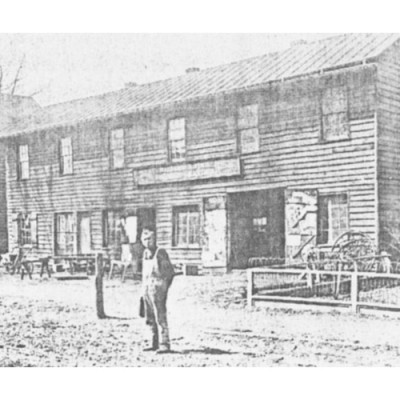 The blacksmith shop on Bridge Street. To the left of it is the wheelwright shop.